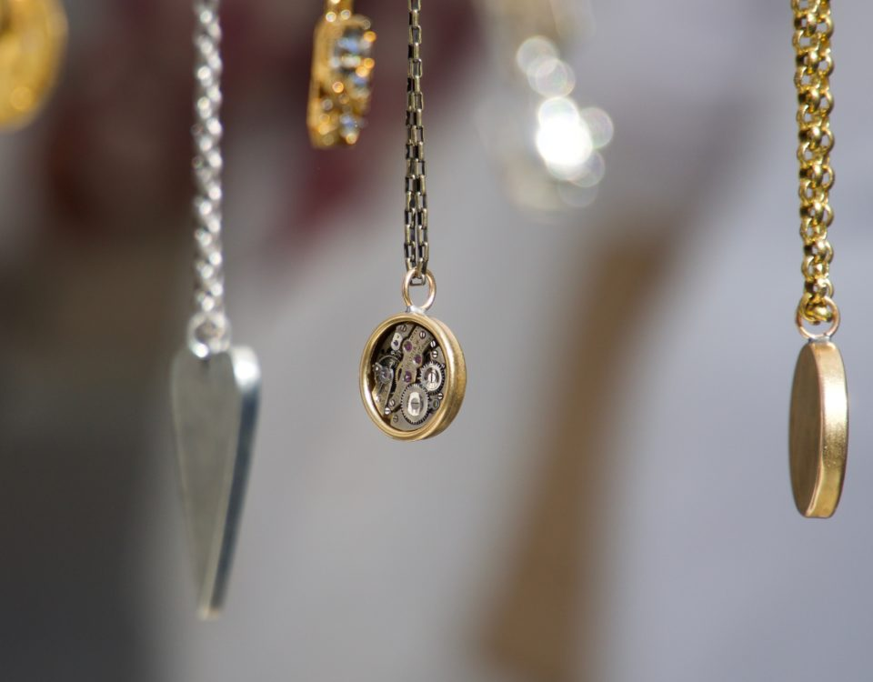 necklaces hanging on a blurred background